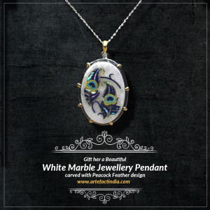 Gift her a Beautiful White Marble Jewellery Pendant carved with Peacock Feather design